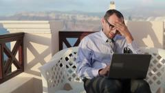 Tired businessman work on laptop and having headache on terrace HD Stock Footage