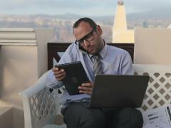 Multitasking busy businessman working on terrace NTSC Stock Footage