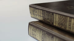 Stack of Books and opened one. Stock Footage
