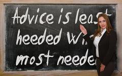 Teacher showing advice is least heeded when most needed on blackboard Stock Photos