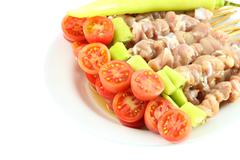 Tomato of fresh pork barbecue before grilled preparation. Stock Photos