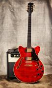 semi-hollow guitar and amplifier - stock photo