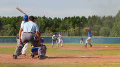 Strike! Batter missing the ball, slowmo - stock footage