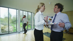 Casual and informal business meeting, colleagues chatting together Stock Footage