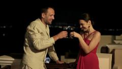 Happy couple raising toast with wine on terrace HD - stock footage