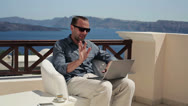 Stock Video Footage of Handsome man chatting on laptop on beautiful terrace HD