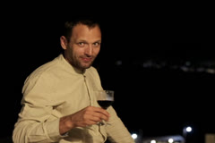 Young man raising toast with glass of wine to camera NTSC - stock footage