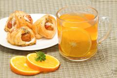 Tea break, orange tea with little  croissant Stock Photos