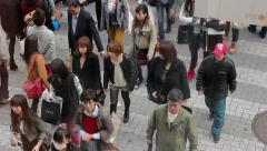People cross Shinsaibashi street, a popular shopping area in Osaka, Japan. Stock Footage