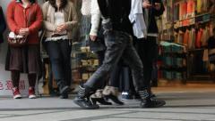 People walking in slow motion in Shinsaibashi shopping district in Osaka. Stock Footage