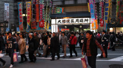 Pedestrians cross street after Grand Sumo Tournament in Osaka. Stock Footage