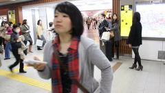 Commuters during rush hour in busy Osaka subway station. Stock Footage