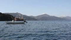 Sightseeing cruise on Lake Ashi with Mount Fuji in the background. Stock Footage