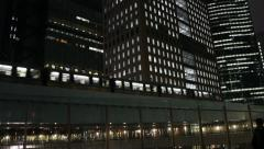 Train and buildings at night in Tokyo - stock footage