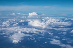 Coudy sky from a window of aircraft Stock Photos