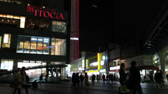 People walk in the Ginza district of Tokyo. Stock Footage