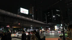 Bullet train crosses over an intersection in Tokyo. Stock Footage