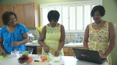three african american women in a kitchen - stock footage