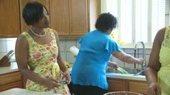 three african american women talking in the kitchen - stock footage