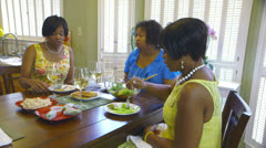 Three women having a light lunch Stock Footage
