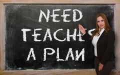 Teacher showing need teaches a plan on blackboard Stock Photos