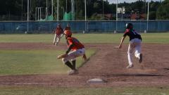 Baseball, tagged at first base Stock Footage