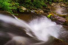 view down a small waterfall on hogcamp branch in shenandoah national park - stock photo