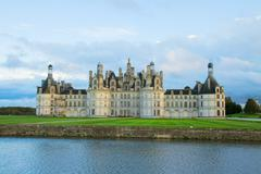 Facade of chambord chateau at sunset, france Stock Photos