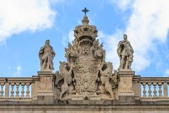 Madrid royal palace, coat of arms on top of palace, spain Stock Photos