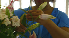 African american woman arranging flowers Stock Footage