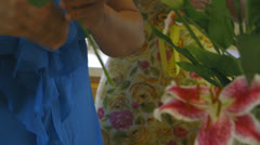 Tilt two women arranging flowers Stock Footage