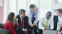 Professionals shaking hands at the conclusion of a business meeting Stock Footage