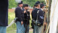 American Civil War Union Soldiers standing in camp Stock Footage