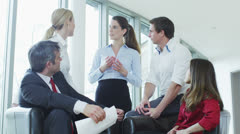 Casual and informal business meeting, colleagues sit together and share ideas Stock Footage