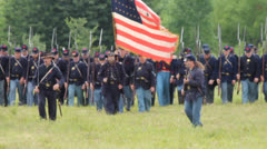 American Civil War Union Soldiers marching across field with Bayonets fixed Stock Footage