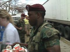 Disaster,African American Airborne Trooper loads relief, Hurricane Andrew damage Stock Footage