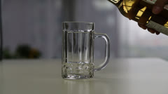 pouring beer to a beer mug - stock footage