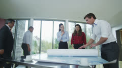 Confident young business team looking at world map in a meeting Stock Footage