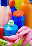 various cleaning products and pink rubber gloves - stock photo