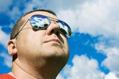 Man in sunglasses sun protection Stock Photos