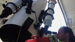 Observing the sky with telescope Stock Footage