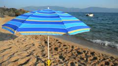 Sunshade on the beach, Corsica, France Stock Footage