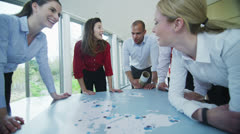 Happy and confident business team looking at world map in a meeting - stock footage