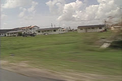 Disaster, drive by damaged church Hurricane Andrew damage Stock Footage