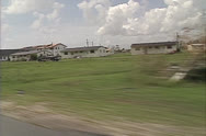 Stock Video Footage of drive by damaged church Hurricane Andrew damage