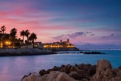 Seascape of antibes at sunset Stock Photos