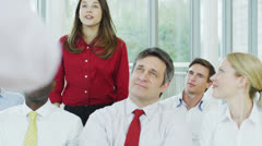 Diverse group of business people listening to a business seminar - stock footage