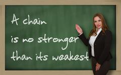 teacher showing a chain is no stronger than its weakest link on blackboard - stock photo