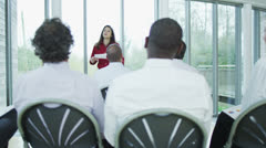 Diverse group of business people listening to a business presentation Stock Footage