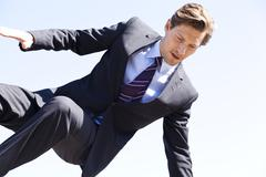 businessman jumping over something - stock photo